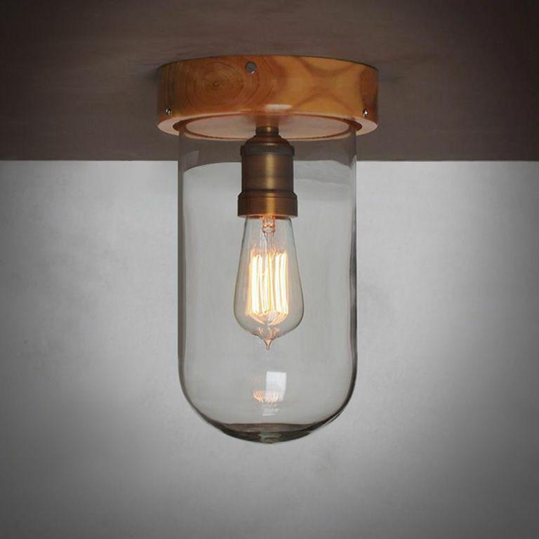 Clear glass cloche ceiling light with wooden base